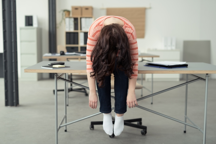 shutterstock_leaning over desk