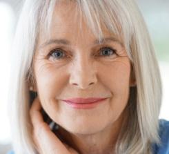 Portrait of senior woman with blue shirt