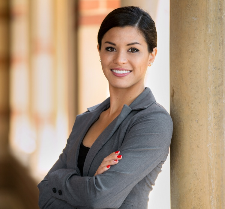 Beautiful young adult lawyer business woman professional in a suit at the courthouse