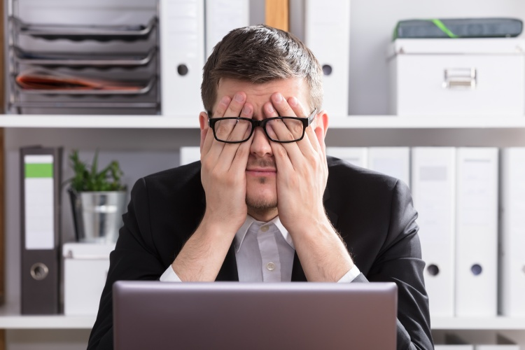 Close-up Of A Tired Businessman