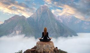 Serenity and yoga practicing,meditation at mountain range